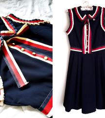 Teget haljina (falte/risici/biserna dugmad)