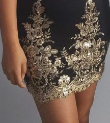 Crna haljina sa zlatnim vezom