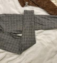Zara karirane pantalone sa istaknutim rajferšlusom