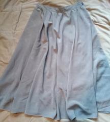Bogata siva suknja. 38