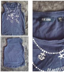 Paket garderobe za devojcicu 122/128 broj