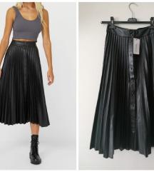 Faux leather suknja,plisirana sa driherima