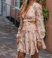 Moderna haljina sa golim ledjima