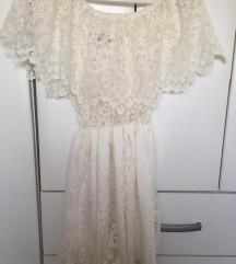 Cipkasta bela haljina