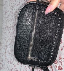 Mini ženska torbica.