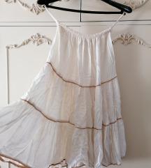 Bela suknja sa zlatnim linijama