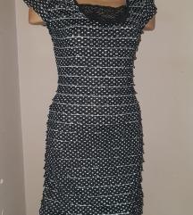 Zanimljiva haljina sa tufnicama vel S