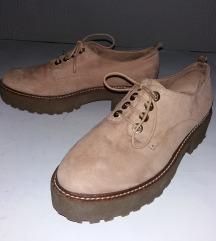 Ultramoderne bežrozikaste cipele na platformi
