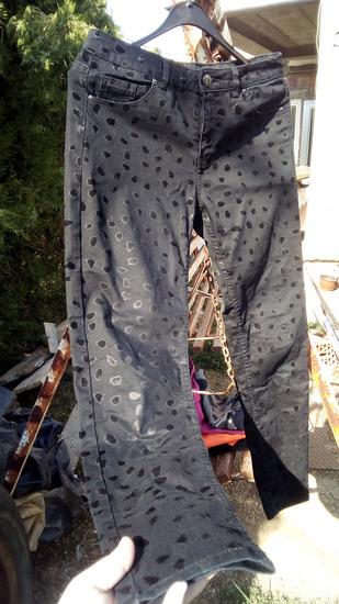 H&M Crne pantalone sa printom flekica