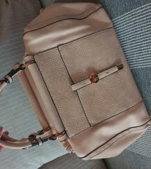 Elegantna prljavo roza torba