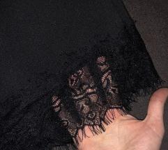 Cipkasta crna suknja