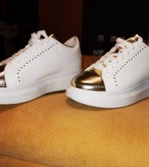 Bele patike sa zlatnim