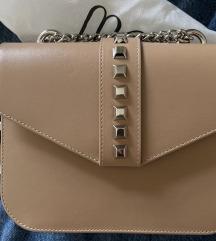 Mona torbica sa etiketom-rezervisano