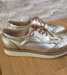 Zlatne elegantne cipele