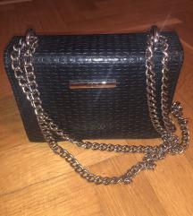 Mona torbica SNIZENO