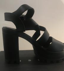 Sisley kozne sandale na visoku stiklu