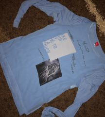 Bebi plava bluza sa slicevima sa strane