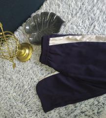 H&M Teget pantalone sa crtom.