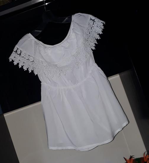 Bela majica kao nova