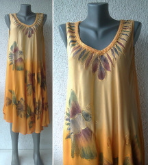 haljina narandžasta za leto 46 ili 48 SAHIBA