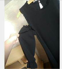 Crna leprsava haljina