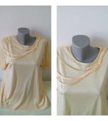 Zuta bluza sa pletenicama