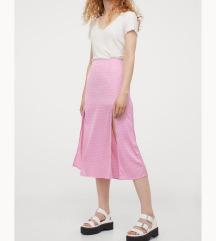 Suknja svilena roze sa slicevima