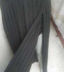 Plisirana duga crna suknja