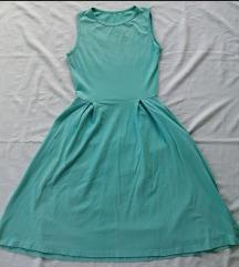 Svetlo-zelena haljina sa džepovima