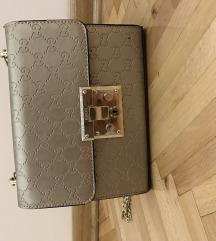 Zlatna torbica na prodaju