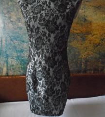 Haljina od crne čipke sa srebrnom pozadinom
