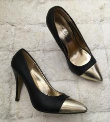 Crno zlatne kozne stikle