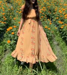 Zuto narandzasta haljina sa cvetovima