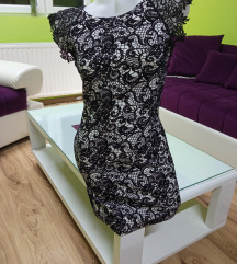 Belo-crna elegantna haljinica