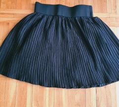 Plisirana suknja sa postavom A kroja
