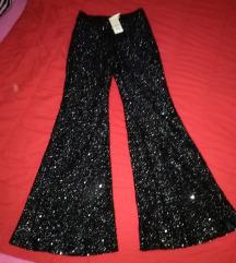 Crne pantalone sa sljokicama