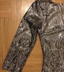 Sljokicava haljina sa golim ledjima