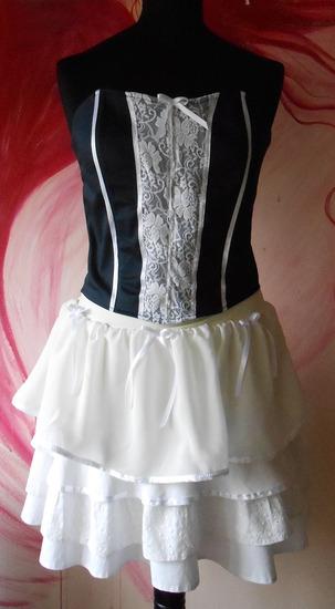 Korset teget sa belom cipkom i kratka bela suknja