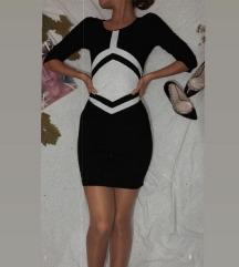 Crna haljina iznad kolena