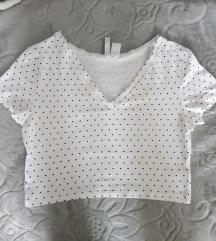 Beli H&M crop top sa V izrezom na tačkice