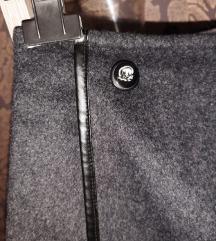 Moderna poslovna suknja sa koznim stepom