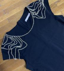 Elegantna crna haljina sa lancima