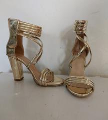 Zlatne stikle,sandale na debelu petu