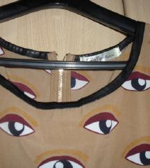 Zanimljiva tunika sa ocima i koznim detaljima