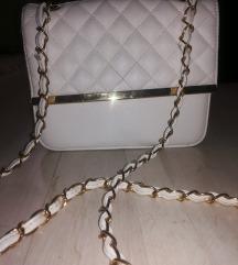 Bela torbica sa zlatnim detaljima
