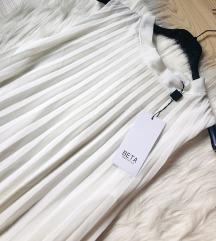 Leprsava bela haljina NOVA sa et.