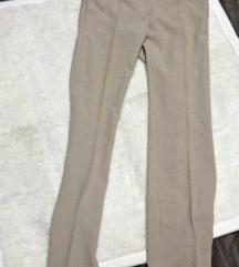 Elegantne krem pantalone  'na ivicu'