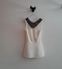 bela peplum majica sa aplikacijom