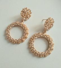 Zlatne okrugle sa teksturom