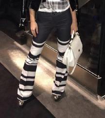 Elegantne pantalone sa sirim nogavicama